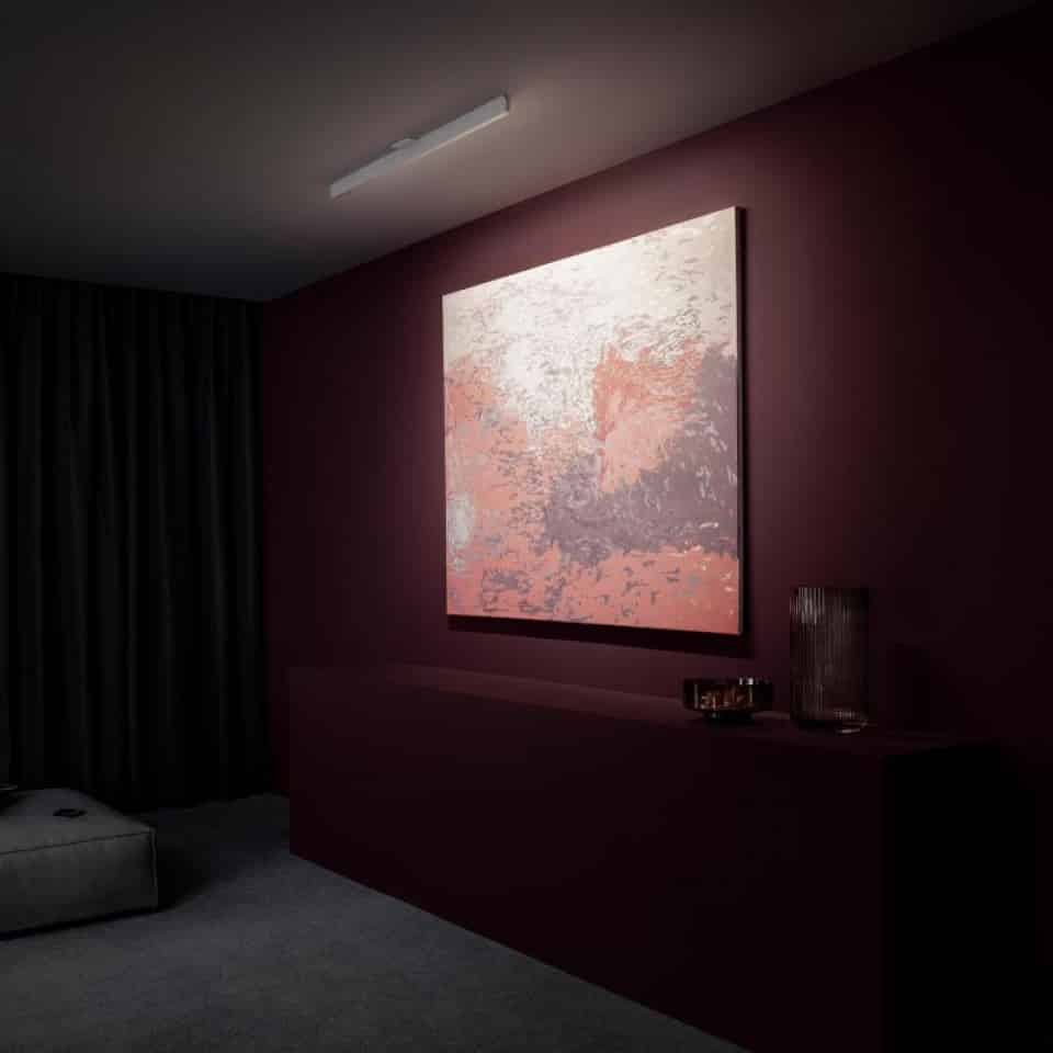 Occhio Mito plafondlamp om een schilderij te verlichten